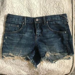 Free People distressed denim shorts